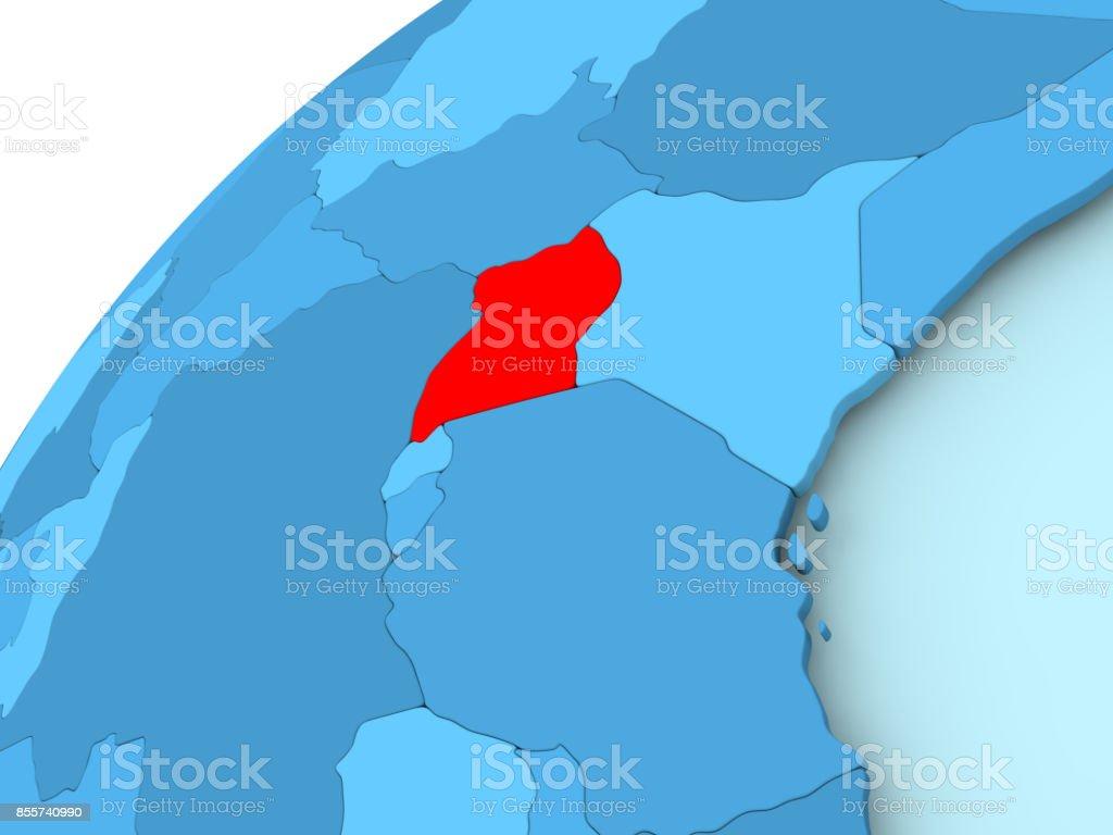 Uganda on blue globe stock photo