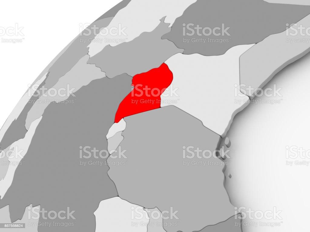 Uganda on grey political globe stock photo