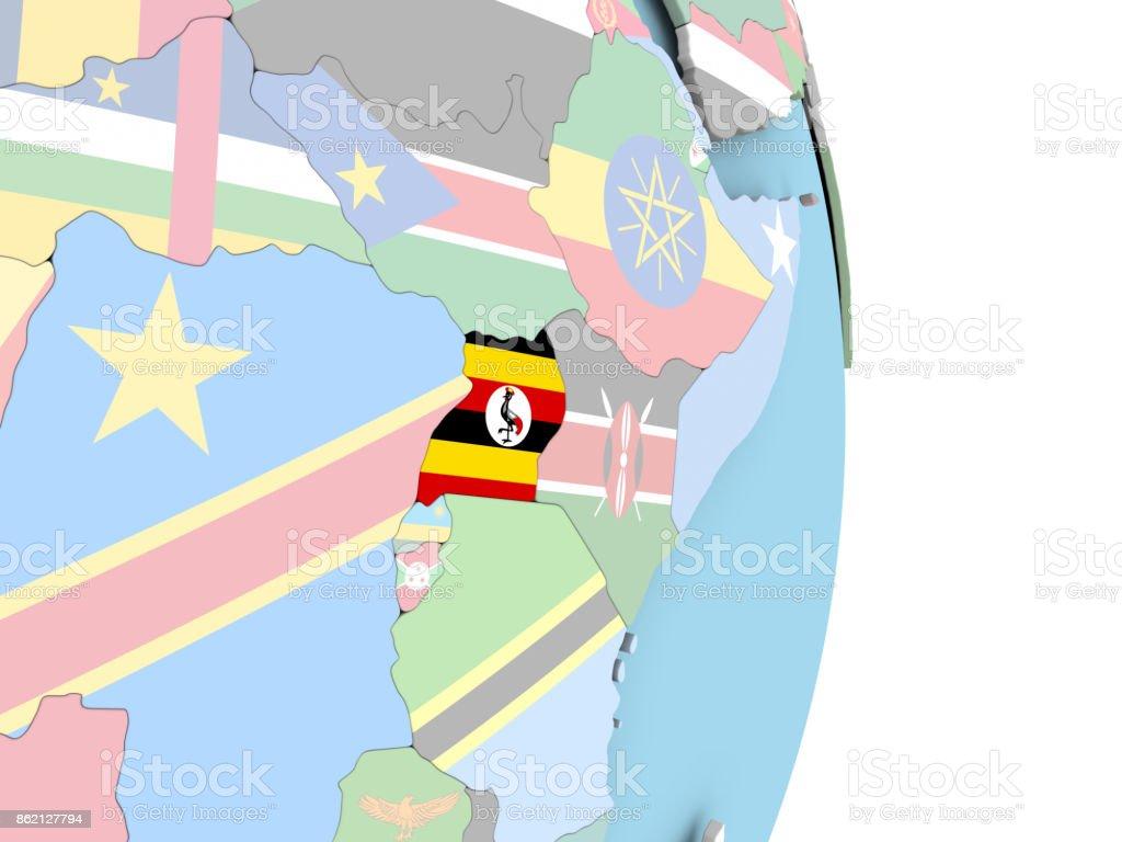 Uganda with flag on globe stock photo