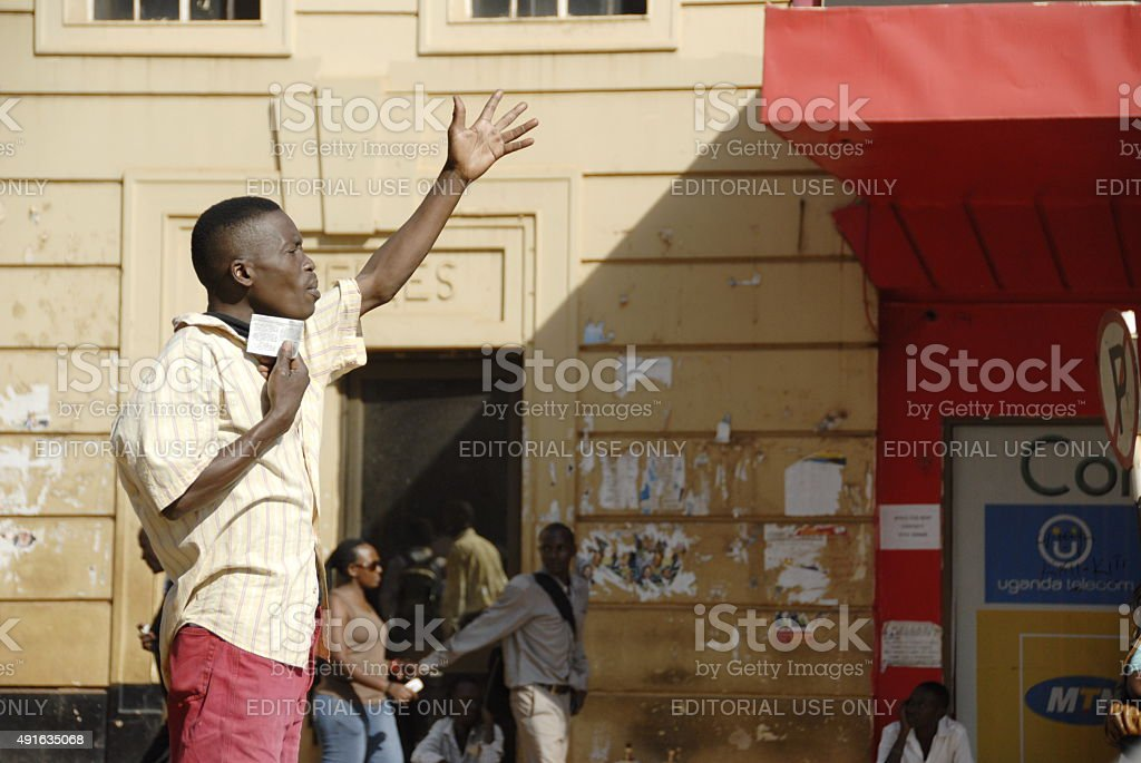 Ugandan man preaches on a street of Kampala, Uganda. stock photo