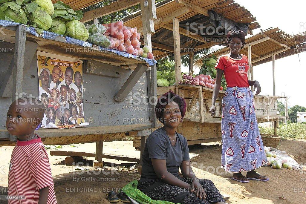 Ugandan women sell vegetables near Masindi, Uganda. stock photo