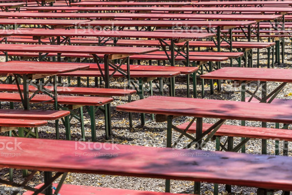 Picture of: Ugly Old Red Wooden Benches And Tables From Which The Paint Peels Off In A Beer Garden In Germany Stock Photo Download Image Now Istock