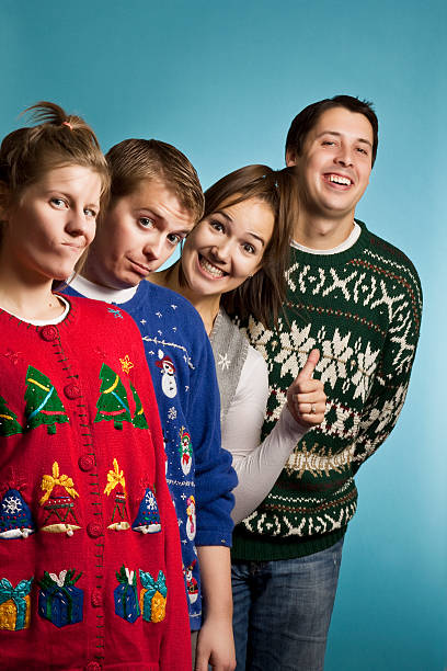 ugly sweater group happy - ugly sweater stock photos and pictures