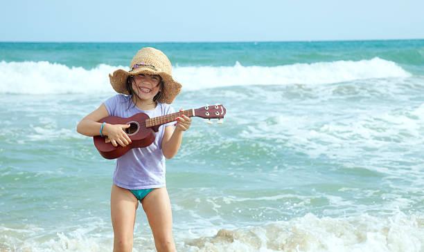 ukulele kind - ukulele songs stock-fotos und bilder