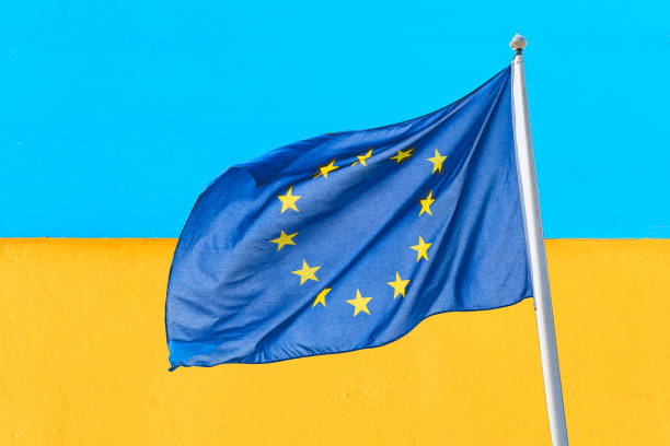 Ukraine and european union waving european union flag against blue picture id1144319377?b=1&k=6&m=1144319377&s=612x612&w=0&h=azwc5lyzb1rakozjdfz uzsyjiaonmdynw wqqjsf o=