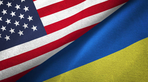 ukraine and united states two flags together realations textile cloth fabric texture - ukraine stock pictures, royalty-free photos & images