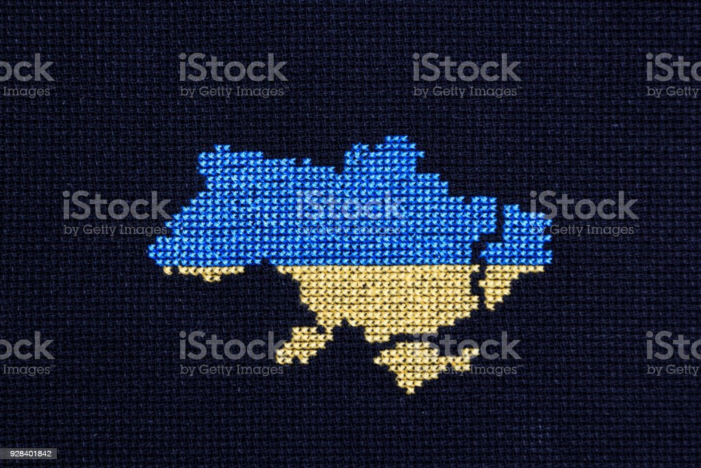 Ukraine embroidered with yellow and blue threads. In the east of the country is a black border. stock photo