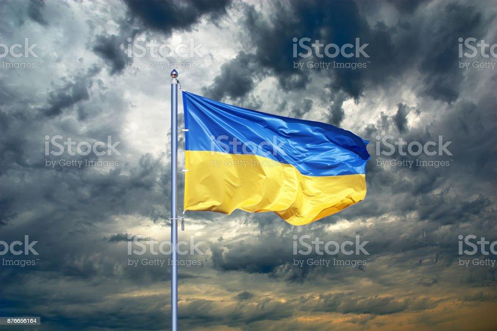 Ukraine flag. Ukrainian flag on black storm cloud sky. stormy weather stock photo