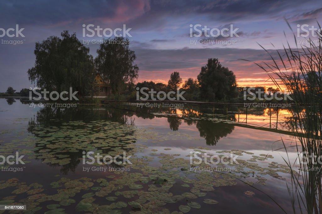 Ukraine. Old Solotvyno. Fisherman's House at sunset. stock photo