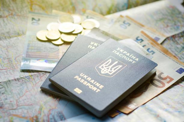 Ukraine passport with money on the map. stock photo