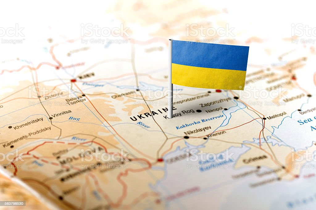 Ukraine pinned on the map with flag stock photo