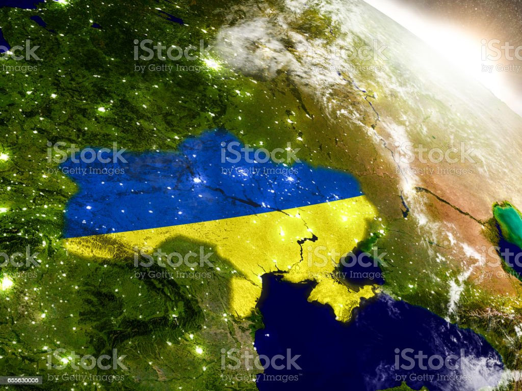 Ukraine with flag in rising sun stock photo