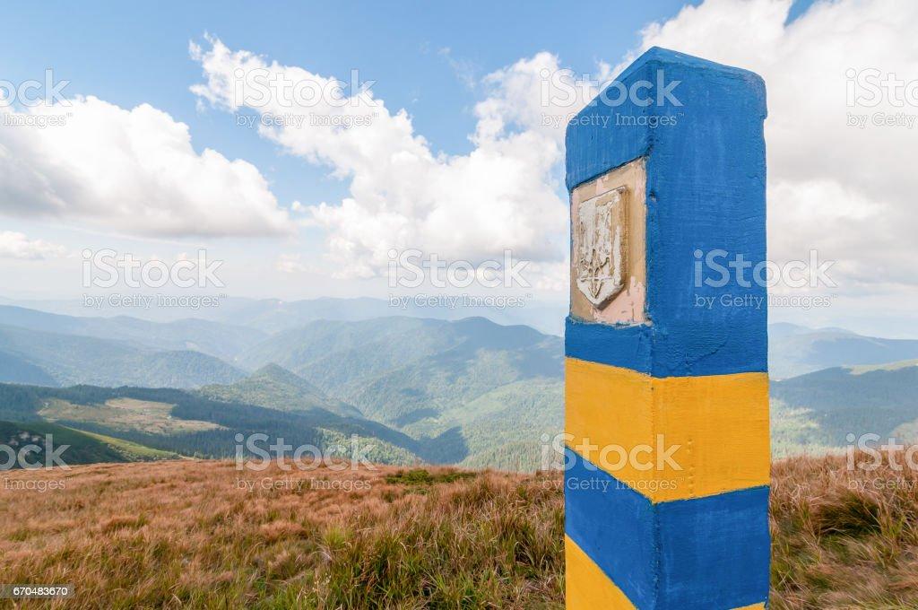 Ukrainian border pillar in Carpatian mountains, as a symbol of visa-free regime with Europe. Open Ukraine and Europian Union travel concept stock photo