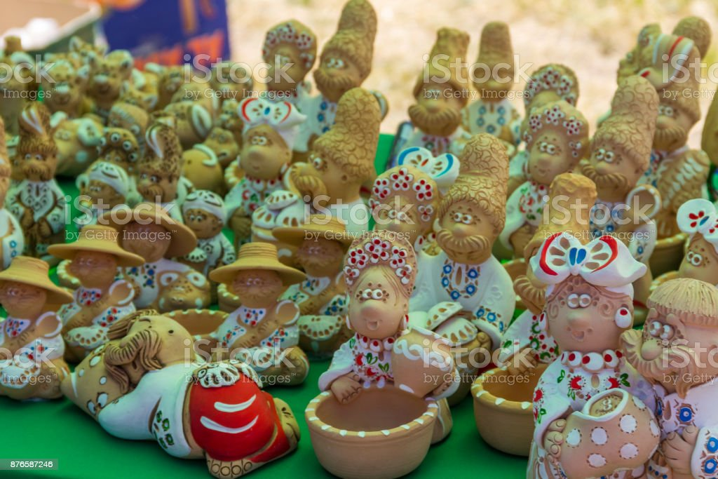 Ukrainian clay figurines for sale on souvenir market stock photo