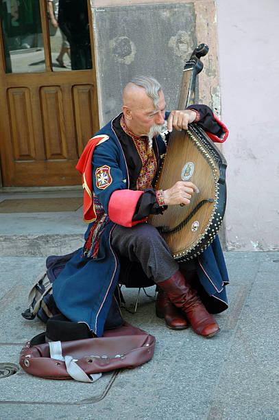 Cтоковое фото Украинская cossak играет на его bandura