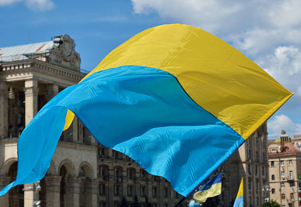 Ukrainian flag flying stock photo