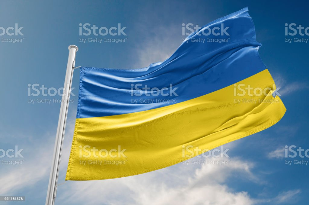 Ukrainian Flag is Waving Against Blue Sky royalty-free stock photo