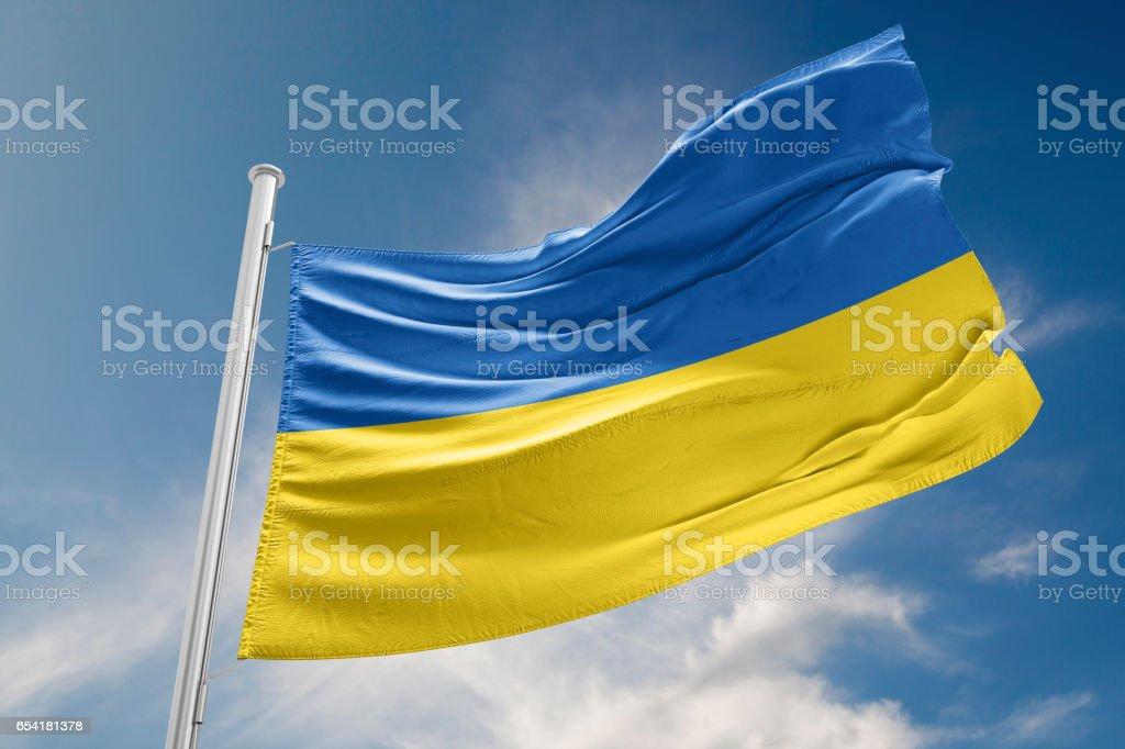 Ukrainian Flag is Waving Against Blue Sky stock photo