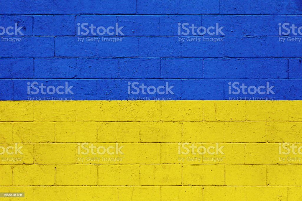 Ukrainian flag painted on a wall stock photo