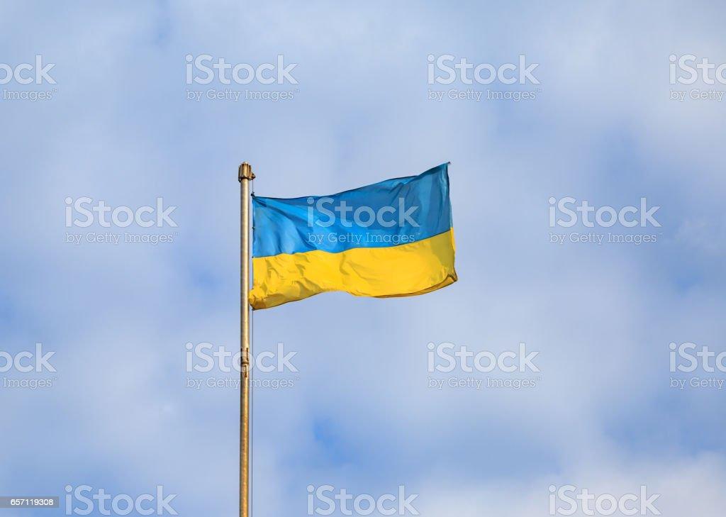 Ukrainian flag with cloudy sky background stock photo