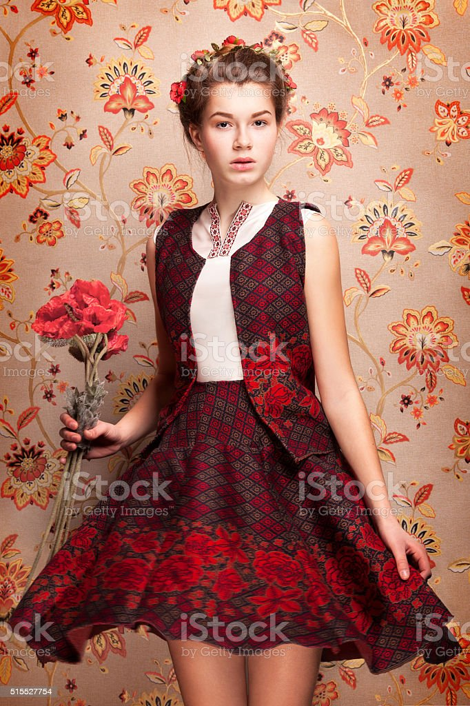 Ukrainian girl with poppies bildbanksfoto