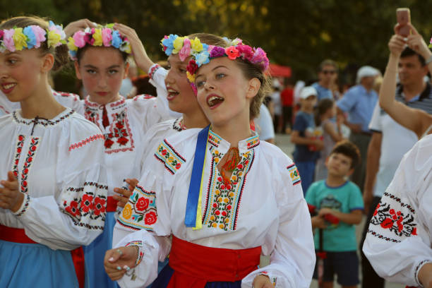 Ukrainian group of dancers in traditional costumes at the International Folklore Festival for Children and Youth - Golden Fish stock photo