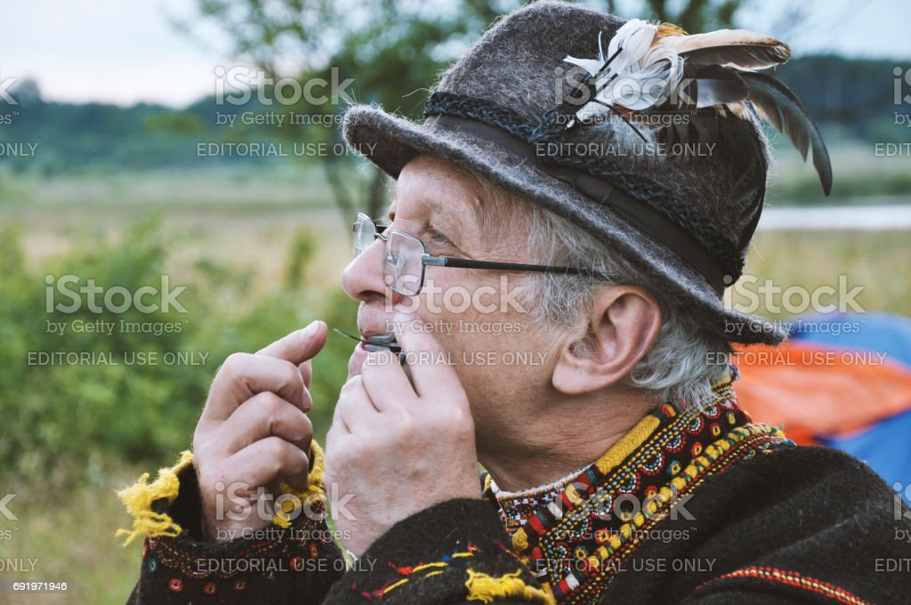 Drohobych, Ukraine - June 29, 2017: Ukrainian man in national dress playing the drymba, annual Embroidery festival stock photo