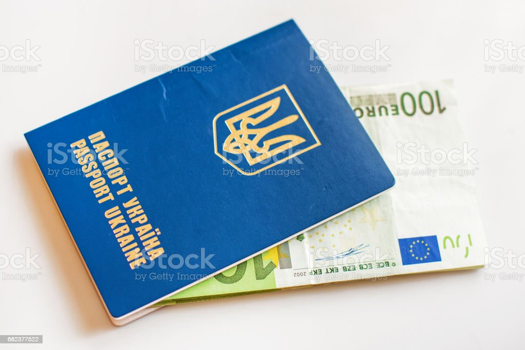 Ukrainian passport for travel abroad of euro banknotes (abolition of Schengen visas for Ukrainian - concept) royalty free stockfoto