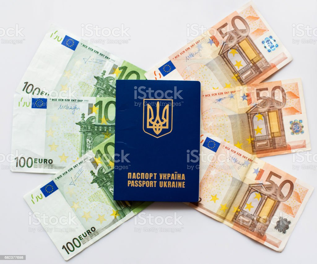 Ukrainian passport for travel abroad on a background of euro banknotes in the form of wings (visa regime for Ukrainian is available Europe - concept) royalty-free stock photo