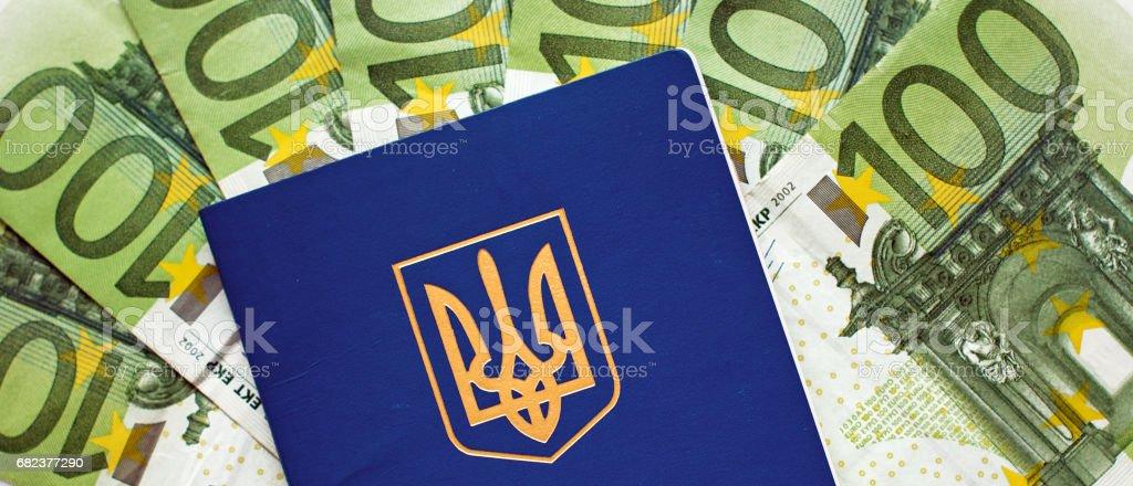 Ukrainian passport for travel abroad on a background of euro banknotes (visa regime for Ukrainian, green light for Ukraine, open Europe - concept) photo libre de droits