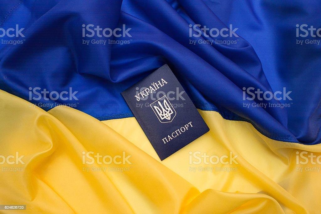 Ukrainian passport on the flag of Ukraine. – Foto