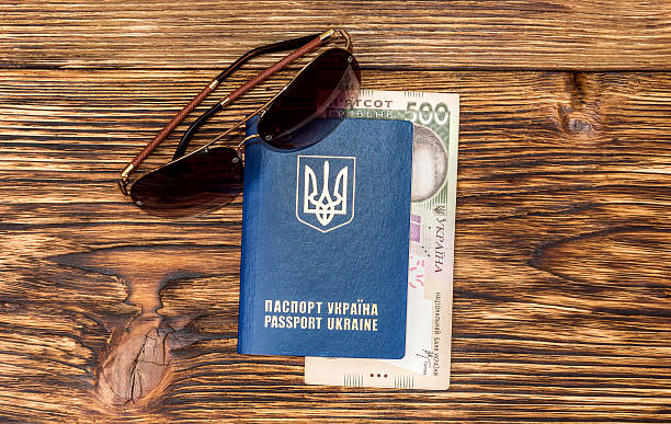 Ukrainian passport with money and glasses on wooden background picture id524900282?b=1&k=6&m=524900282&s=612x612&w=0&h=tpon643ntw8pp xtvgk95sqdelxjscq7uc55b03yfx0=
