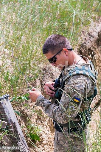 968849772istockphoto Ukrainian sapper sets pyrotechnic charge 587948544