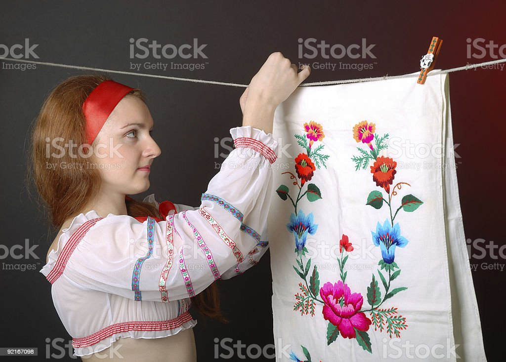 Ukrainian woman hanging towel embroidered stock photo