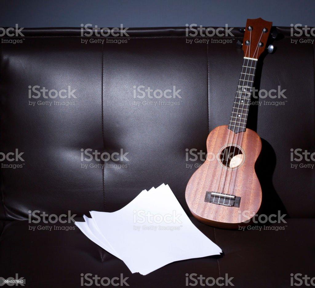 Ukulele and Blank Music Paper Notes royalty-free stock photo