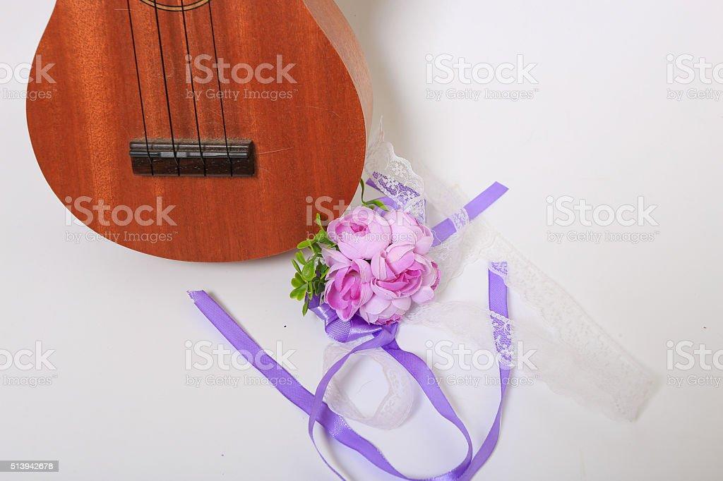Ukulele and flowers stock photo
