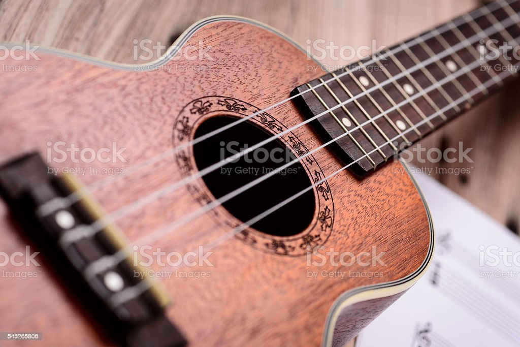 Ukulele and musical paper notes stock photo