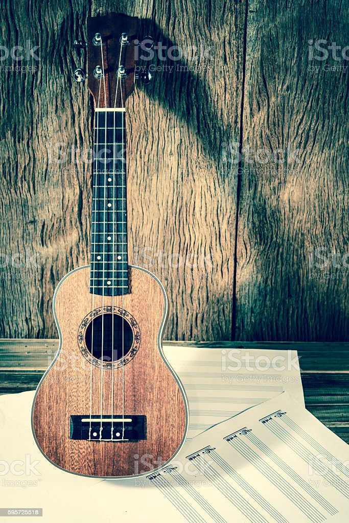 Ukulele and musical  paper notes ; vintage filtered style stock photo