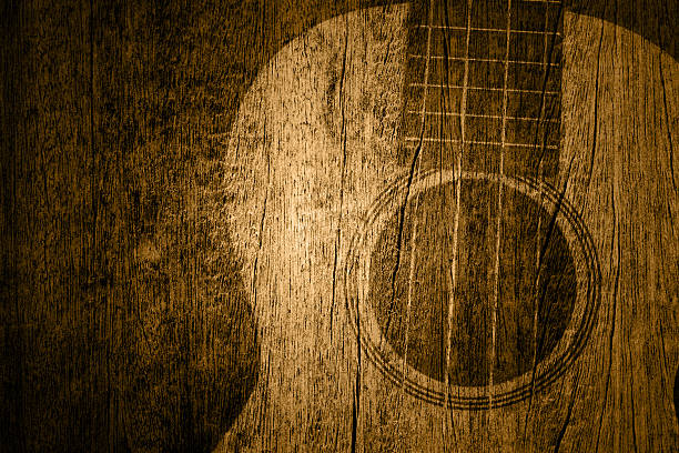 Ukulele in wood texture background Ukulele in wood texture country and western music stock pictures, royalty-free photos & images