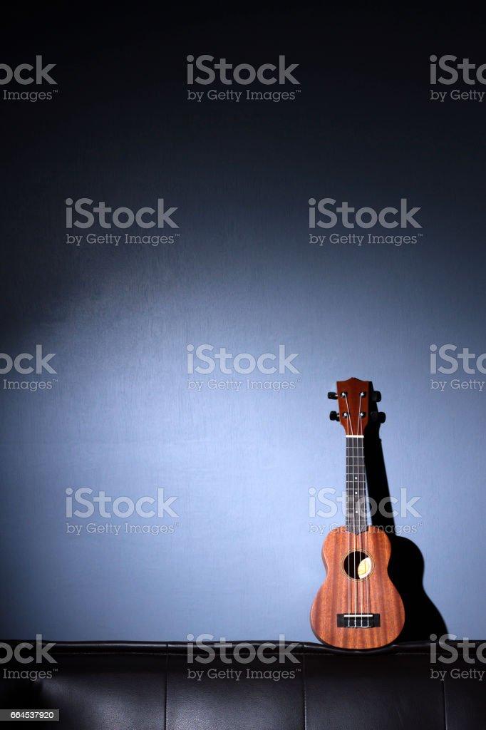 Ukulele on Gray Background. royalty-free stock photo