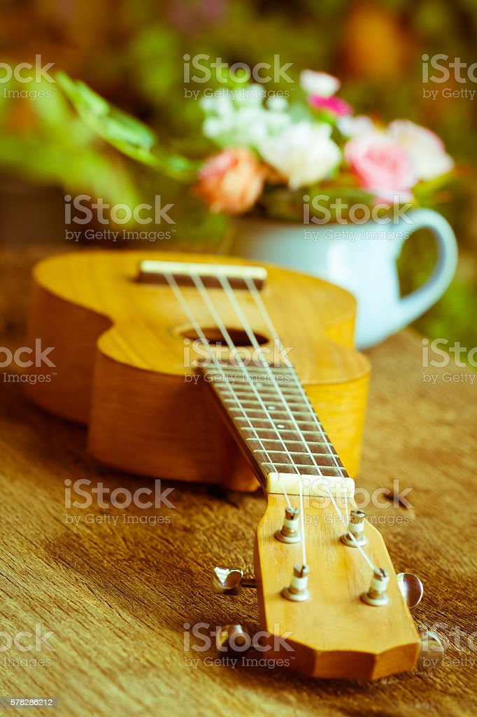 Ukulele  over old wood in vintage style,Selective focus stock photo