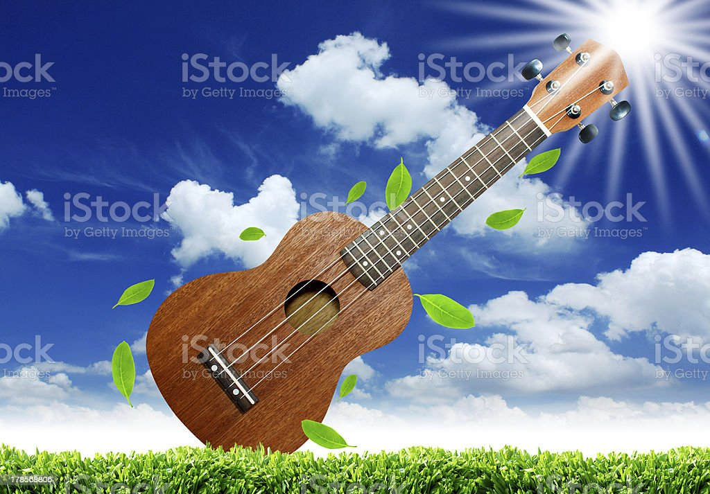 Ukulele with blue sky. royalty-free stock photo