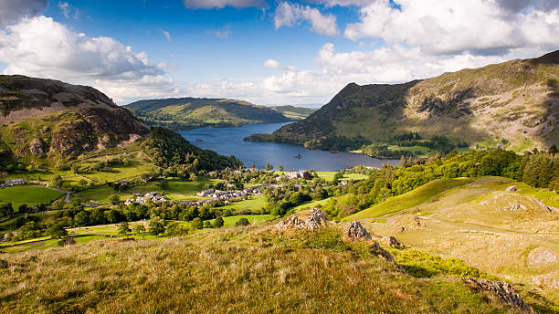 Ullswater at Glenridding Ullswater lake curves through the mountains of the English Lake District at Glenridding, looking down on the lake from the crags of Birkhouse Moor. cumbria stock pictures, royalty-free photos & images