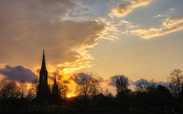 Ulm minster sunset Sunset silhouette of the Ulmer Münster ulm minster stock pictures, royalty-free photos & images