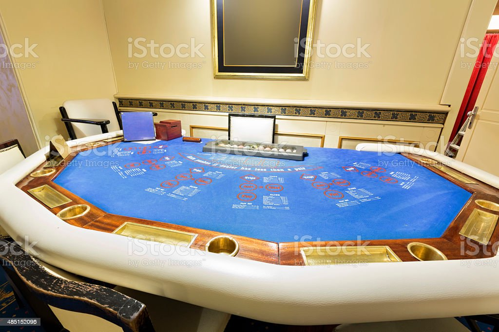 Ultimate texas hold 'em poker table at casino stock photo