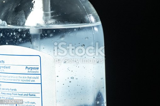 Ultra Close-Up Macro Artsy Shot of Antiseptic Gel Hand Sanitizer Label Purpose with Alcohol and Aloe Vera Bubbles To Prevent the Spread of COVID SARS nCoV 19 Coronavirus Swine Flu H7N9 Influenza Illness During Cold and Flu Season stock photo
