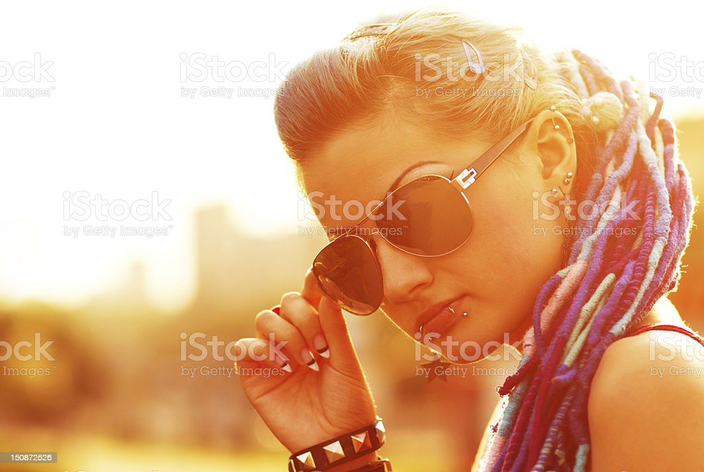 Ultra cool punk girl at sunset stock photo
