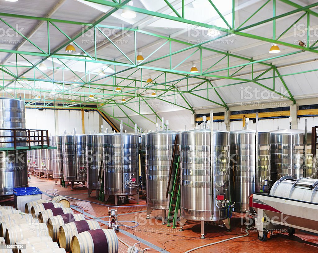 Ultra modern winery with stainless steel casks and holding tanks royalty-free stock photo