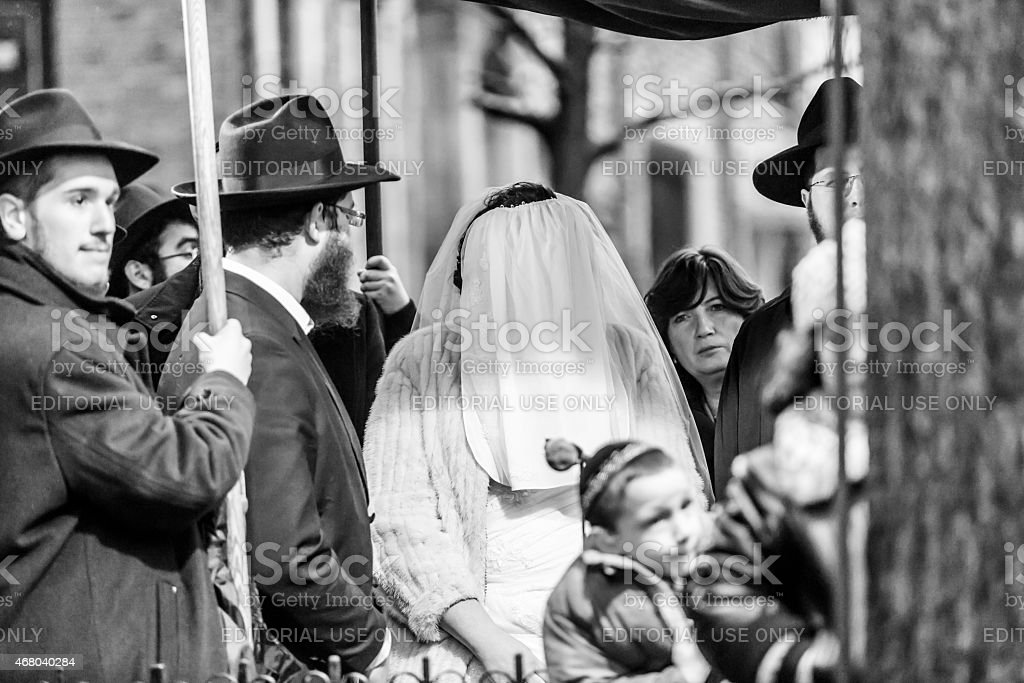 Ultra Orthodox Jewish couple stand under the Chuppah stock photo