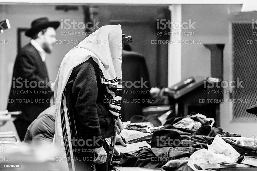 Ultra Orthodox Jewish man prays during service stock photo